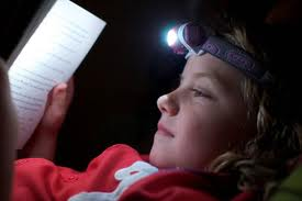 How to read a book with a flashlight take a picture with your ten percent battery life left phone and tweet it headlamp reading makes the cutest of candids check it sciox Gallery