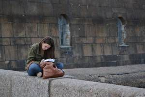 Girl reads a book in St. Petersburg, Russia