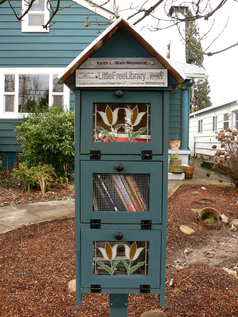 A Little Free Library in Portland, OR, photographed by Rioter Jill Guccini