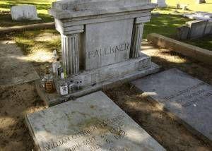 Fauikner's grave, complete with bourbon bottles.  Photo by Alysia Burton Steele