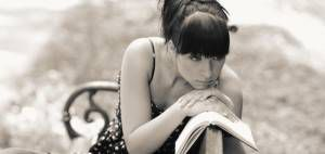 sad girl with book