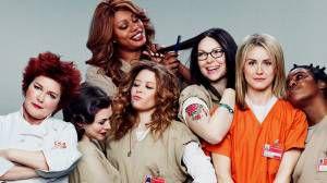 Smiling women in prison uniforms