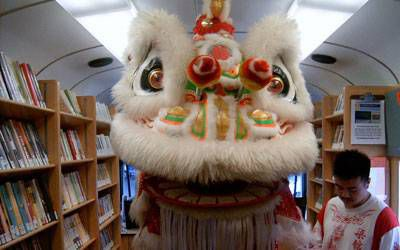 Dragon puppet in interior of bookmobile