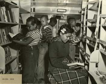 children browse inside a bookmobile.
