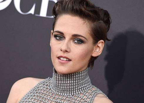 Kristen Stewart in a metallic mesh turtleneck w/ a helmet-style hairdo