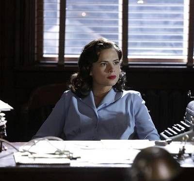 Agent Carter sits at a desk