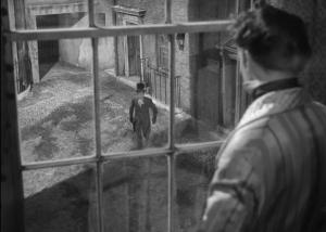 Great Expectations 1946 - Pip loks down at Joe