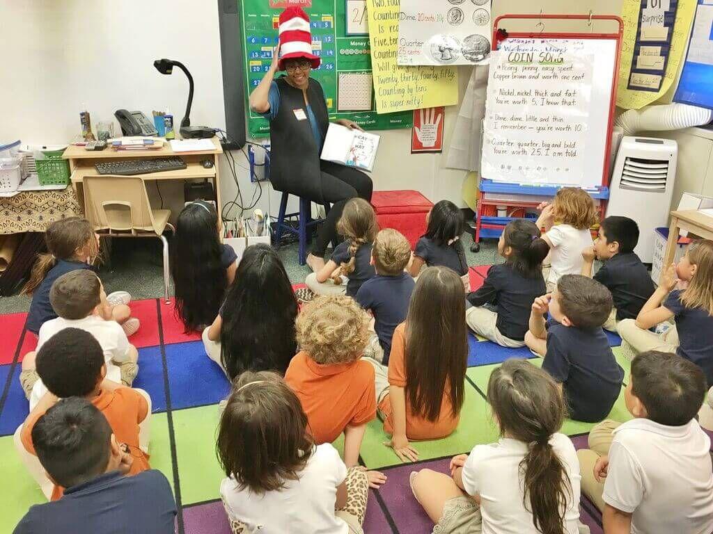 Maya reading a book to children