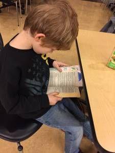 Child Reading Novel