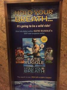Advertising for romance author Katie Ruggle's Search and Rescue series on elevator doors at the Rio hotel