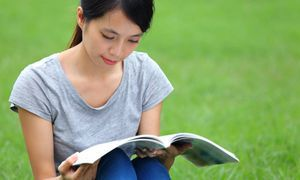 asian woman reading