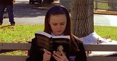 image of Rory Gilmore reading a book on a bench