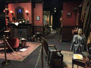 Half of the recreation of the sitting room at 221B. (Note the wax dummy with a bullet hole in its forehead.)