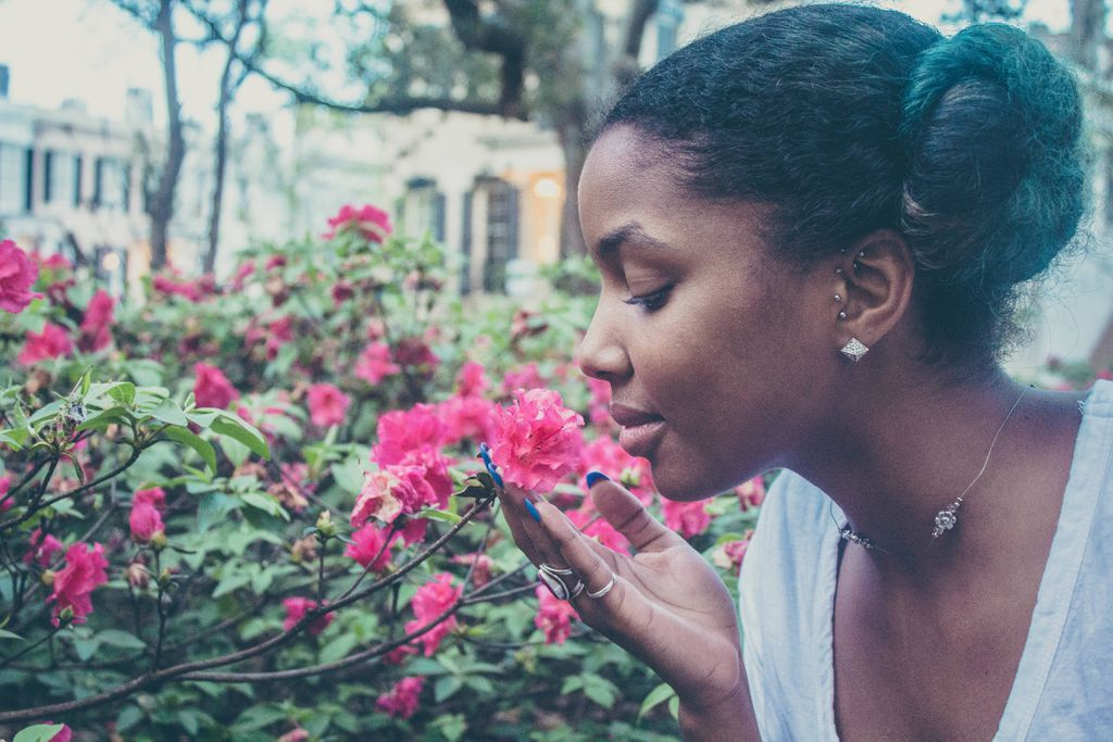 Black woman smells the flowers
