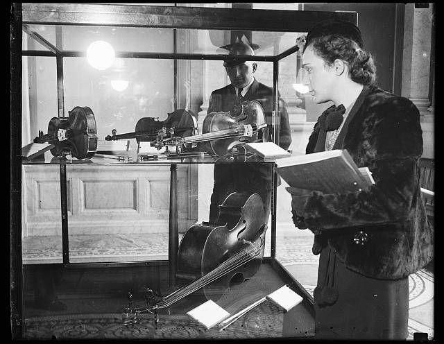 Woman viewing violin display