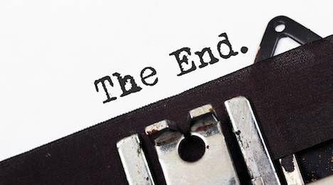 Retro typewriter text the end on white paper