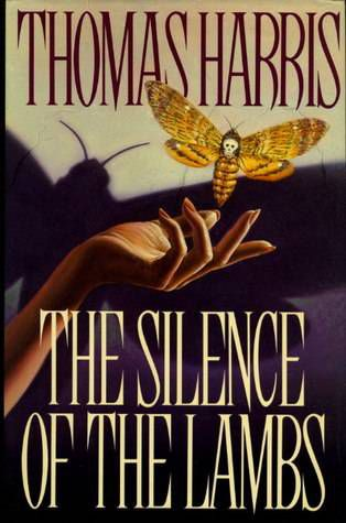 cover of silence of the lambs thomas harris, feauting a woman's forearm and hand, with a death's head moth flying above it