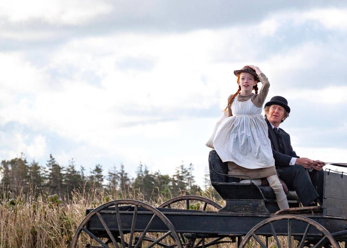 Matthew Cuthbert and Anne Shirley ride in a buggy in Netflix's Anne Of Green Gables adaptation