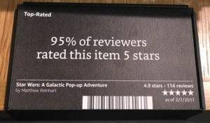 """black placard attached to a table that says """"95% of reviewers rated this item 5 stars."""""""
