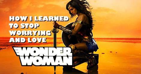 Wonder Woman kneeling on beech with sword