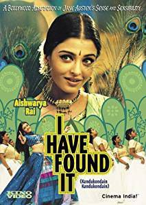 """Movie cover of """"I Have Found It"""". Close up of an Indian woman's face with peacock feather background"""