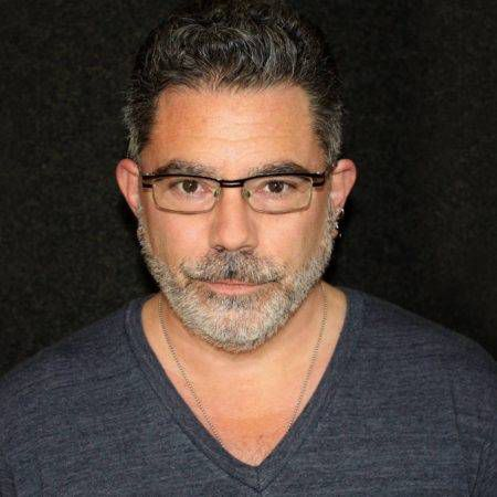 head shot of audiobook narrator with gray beard and glasses