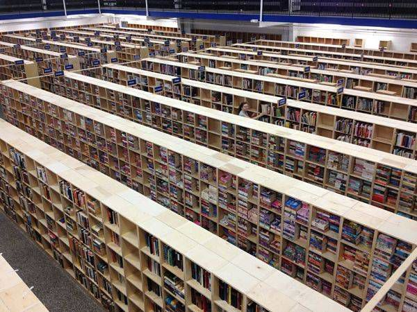 My bookstore anniversary - Thoughts after working 10 years at a bookstore: Me shelving books in a new bookstore