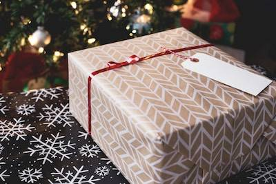 A Gift Wrapped Box Tied With Red Ribbon