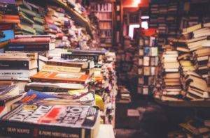 Stacks of books in a bookstore.