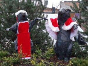 Mr. and Mrs. Beaver statues in the C.S. Lewis Square in Belfast - They are outfitted in Santa hats and cloaks