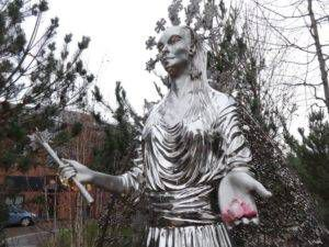 The silver White Witch statue holding Turkish delight at the C.S. Lewis Square in Belfast