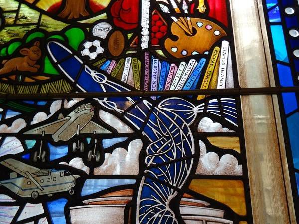 Section of a stained glass window in Belfast City Hall featuring C.S. Lewis - a spot off the beaten C.S. Lewis trail in Belfast