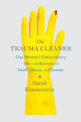 the trauma cleaner cover image: yellow latex glove on white background with spot of blood on index finger tip