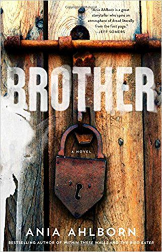 cover of brother ania ahlborn, featuring a wooden door with a large rusted padlock on it