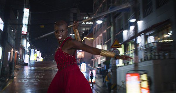 Okoye swinging her spear in the Black Panther movie