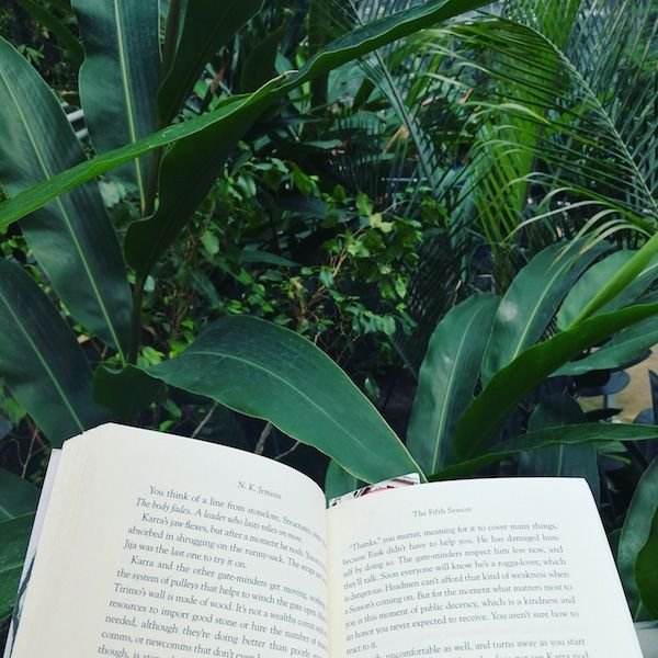 Reading in the Cloud Gardens Conservatory in downtown Toronto.