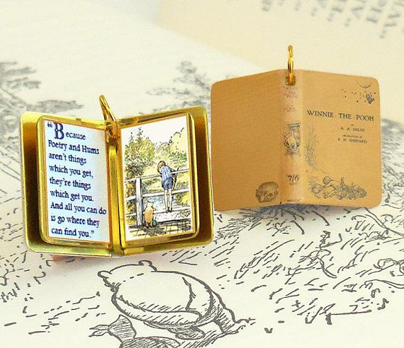 Gold book-shaped pendant with color Winnie-the-Pooh illustration and quote