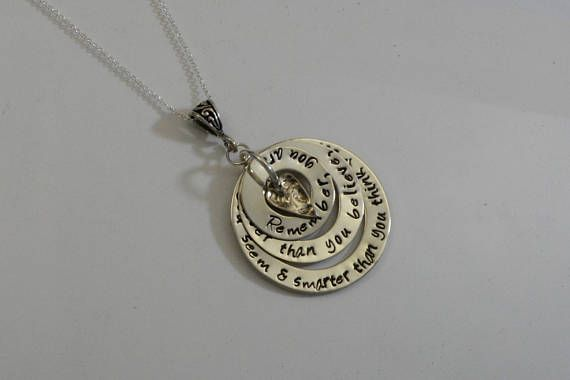 Silver layered necklace stamped with text