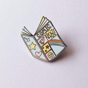 Comic Book Pin from 20 Enamel Pins For The Comic Geek | bookriot.com