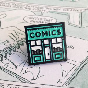 Comics Shop from 20 Enamel Pins For The Comic Geek | bookriot.com