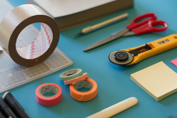 photo of tape, scissors, and other craft supplies laid out