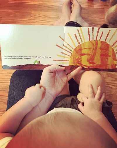 Contributor Dana Staves reads with her child, shared in celebration of bookish moms for Mother's Day