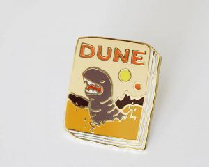 Dune Book Pin from 25 Bookish Enamel Pins You Need In Your Life | bookriot.com