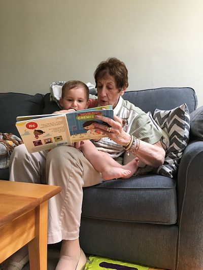 Contributor Jaime Herndon's grandmother reads to her child, shared in celebration of bookish moms for Mother's Day
