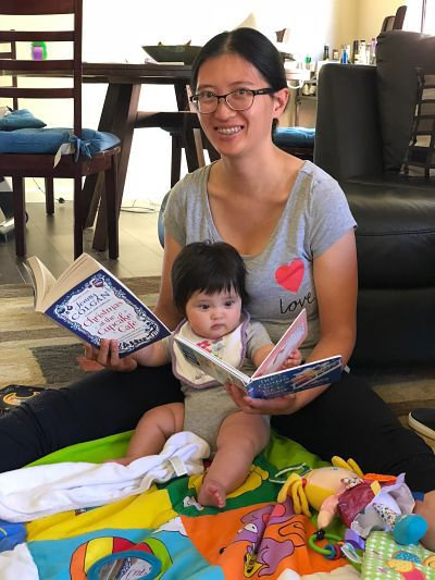Contributor Jen Sherman reads with her child, shared in celebration of bookish moms for Mother's Day