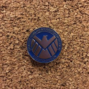 SHIELD Pin from 20 Enamel Pins For The Comic Geek | bookriot.com