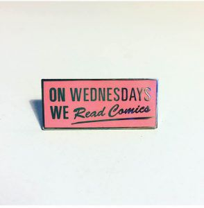 On Wednesdays We Read Comics Pin from 20 Enamel Pins For The Comic Geek | bookriot.com
