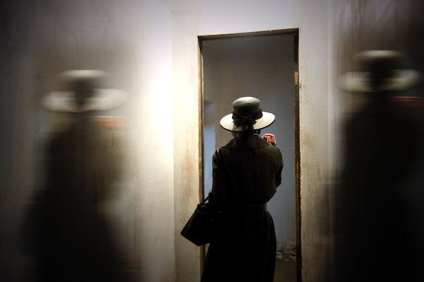 photo of woman in hat by Monica Silva