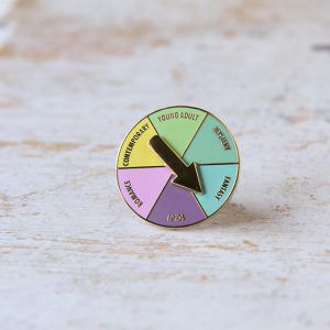 Reader Roulette Pin from 25 Bookish Enamel Pins You Need In Your Life | bookriot.com