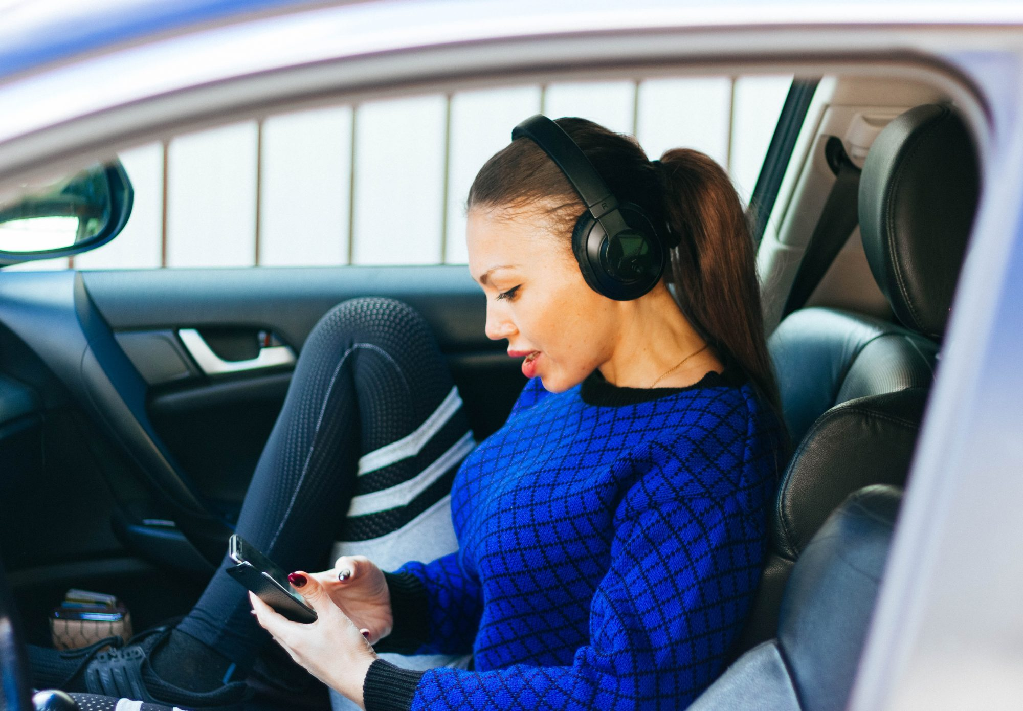 girl-in-car-with-headphones